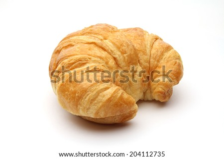 An isolated croissant on white background - stock photo