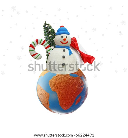 An isolated cutout of a Snowman with a Christmas tree, presents and candy cane on a earth globe with snow flakes falling around it. - stock photo