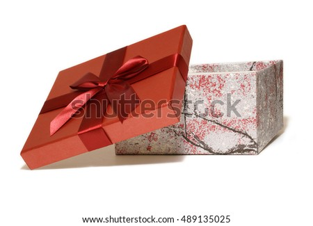 An isolated gift box with the red lid off it for inserting your designs - two images with slightly varying angles on the box for your certain needs.