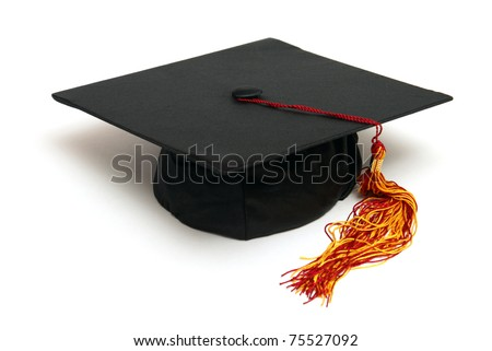 An isolated grad hat to symbolize a student graduating. - stock photo