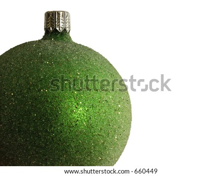 An isolated green Christmas ornament.