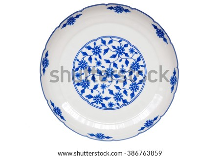 An isolated image of a ceramic dish with blue patterns. - stock photo