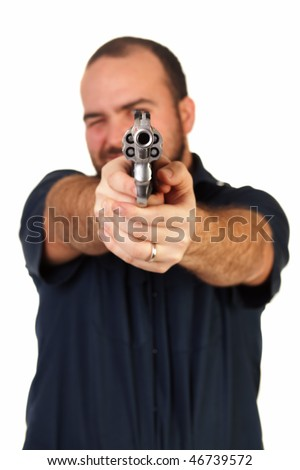 an isolated man aiming a loaded pistol at the camera - stock photo