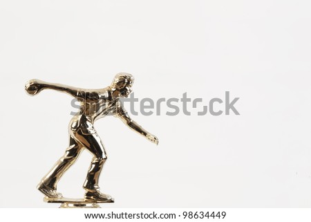 An isolated on white background gold bowling competition trophy. - stock photo