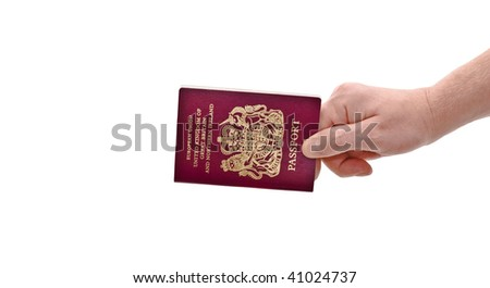 an isolated over white caucasian man's hand holding a European Union British passport - stock photo