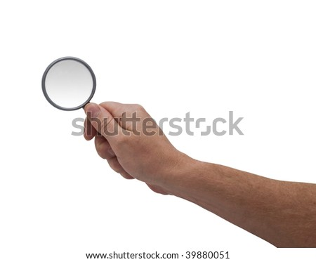 an isolated over white caucasian man's hand holding a magnifying glass.