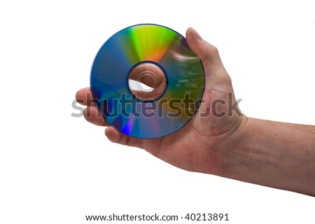 an isolated over white image of a caucasian man's hand holding a CD or DVD disk. - stock photo