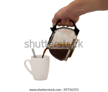 an isolated over white image of a caucasian man's hand holding and pouring coffee into a white mug complete with spoon.