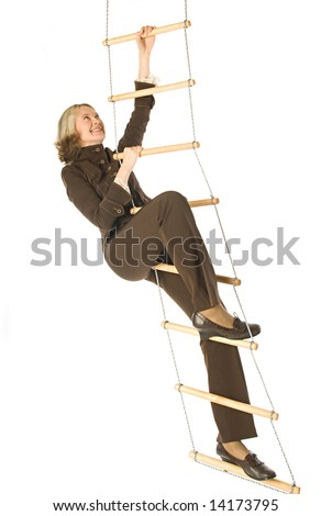 An isolated photo of a businesswoman climbing a rope-ladder
