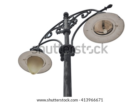 An isolated photo of an old street lamp - stock photo