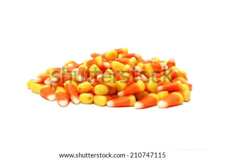 An isolated pile of candy corn for the halloween season.