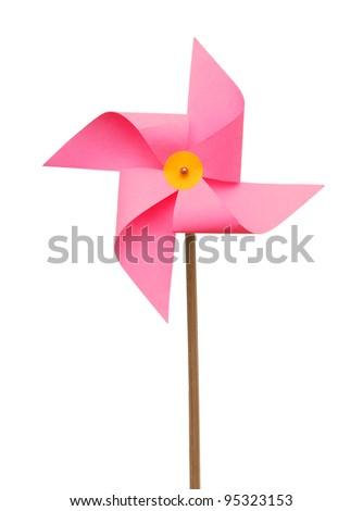 An isolated pink pinwheel on white - stock photo