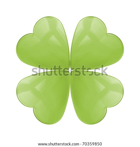 An isolated reflective glass four leaf clover - stock photo