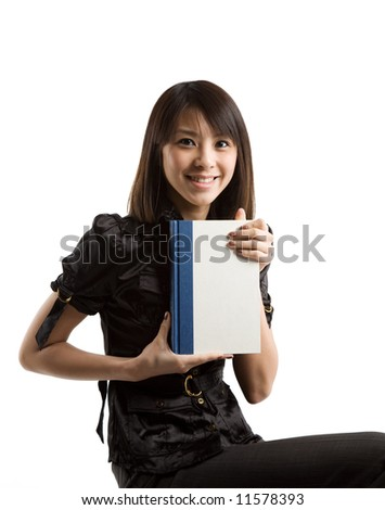 An isolated shot of a asian student carrying a book