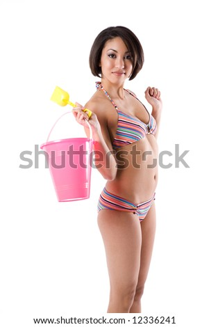An isolated shot of a beautiful and sexy black woman carrying a sand bucket