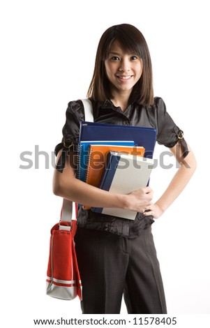 An isolated shot of a beautiful asian student carrying books