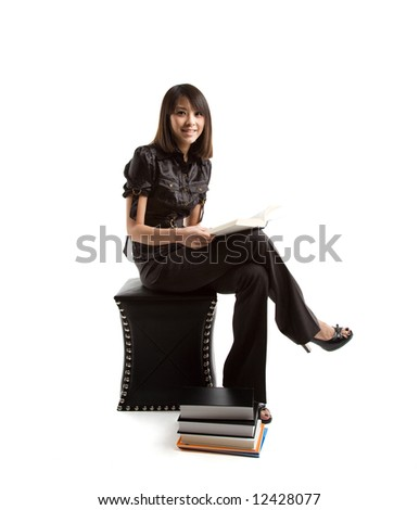 An isolated shot of a beautiful asian student studying - stock photo