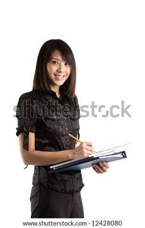 An isolated shot of a beautiful asian student writing on a notebook - stock photo