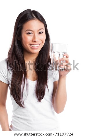 An isolated shot of a beautiful asian woman holding a glass of water