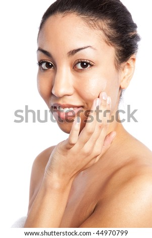 An isolated shot of a beautiful black woman applying  lotion