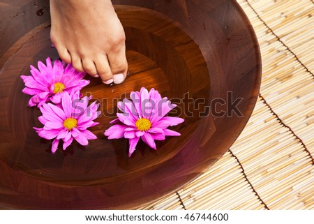 An isolated shot of a beautiful black woman receiving spa treatment - stock photo