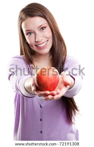 An isolated shot of a beautiful caucasian woman holding an apple