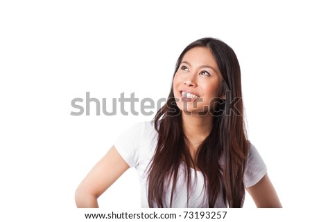 An isolated shot of a beautiful happy asian woman looking up - stock photo