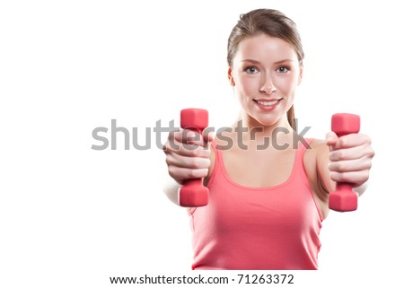 An isolated shot of a beautiful sporty caucasian woman lifting dumbbells
