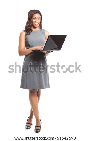 An isolated shot of a black businesswoman holding a laptop - stock photo