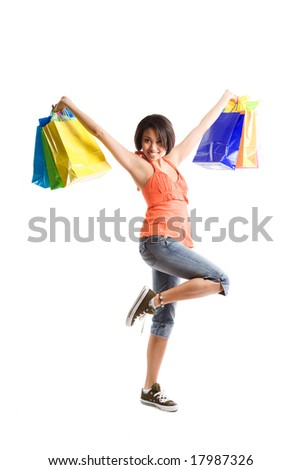 An isolated shot of a black woman carrying shopping bags