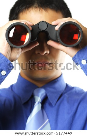 An isolated shot of a businessman looking through a binocular