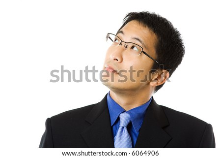 An isolated shot of a businessman looking up - stock photo