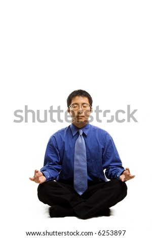 An isolated shot of a businessman meditating - stock photo