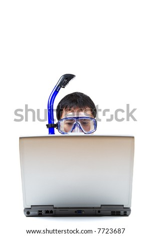 An isolated shot of a businessman wearing a snorkeling equipment while working on a laptop. Can be used to convey the idea of a businessman unable to go for a vacation because of his work.