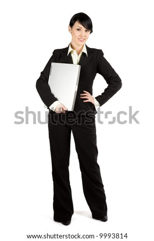 An isolated shot of a businesswoman carrying a laptop - stock photo