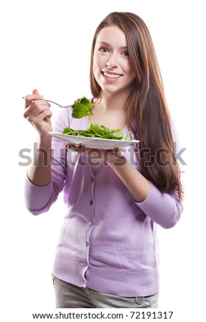 An isolated shot of a caucasian woman holding a plate of salad