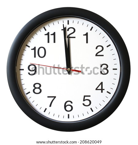 An isolated shot of a clock with one minute left to 12. - stock photo