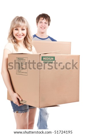 An isolated shot of a moving couple carrying boxes - stock photo
