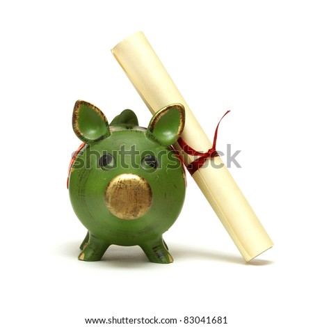 An isolated shot of a piggy bank and diploma scroll for saving for an education. - stock photo