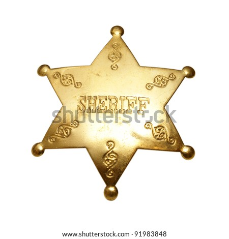 An isolated shot of a sheriff badge. - stock photo