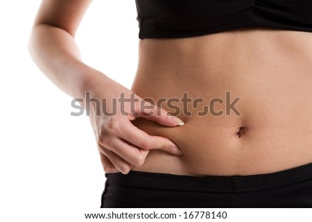 An isolated shot of a slim girl measuring her body fat - stock photo