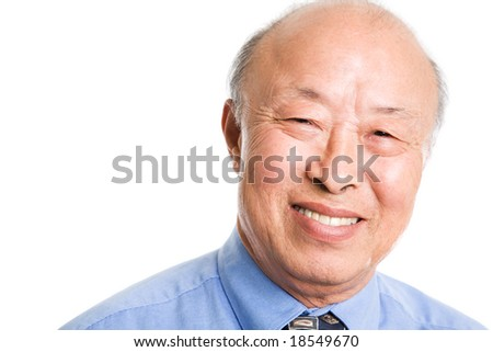 An isolated shot of a smiling senior asian businessman - stock photo