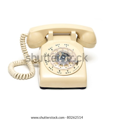 An isolated shot of a traditional rotary phone. - stock photo