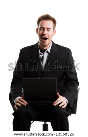 An isolated shot of a yawning caucasian businessman - stock photo