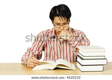 An isolated shot of a young man reading books - stock photo