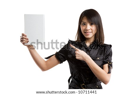 An isolated shot of an asian college student carrying a book