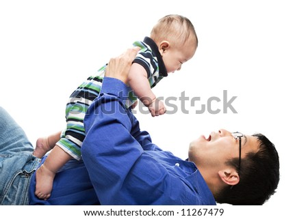 An isolated shot of an asian father and a son cuddling - stock photo