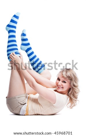 An isolated shot of beautiful woman wearing stripes socks - stock photo