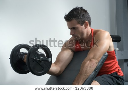 An isolated shot of male athlete curling a dumbbell, with his right arm. - stock photo