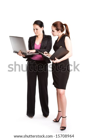An isolated shot of two businesswomen working together - stock photo